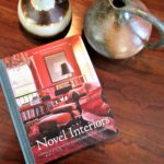A Boho Classic Revisited: 'Novel Interiors' - book on table with pottery