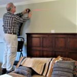 An Easy Way to Hang a Small Rug & More ('Mad Men' Office/Guest Room Redo - 4) - Chris striking level