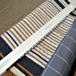 An Easy Way to Hang a Small Rug & More ('Mad Men' Office/Guest Room Redo - 4) - wall rug mount with Command strips